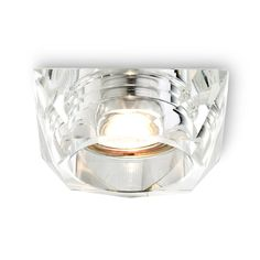 Recessed light with a shade of clear glass.