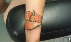 Aww fox tattoo all curled up! It's too cute!