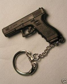 Miniature Glock 17 9mm Replica Gun Keychain by JinJing777 on Etsy, $9.95 Every Girl needs one of these!