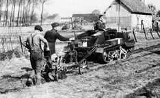 The Royal Irish Fusiliers of the British expeditionary forces come to the aid of French farmers whose horses have been commandeered by the French Army. A tank is hitched to a plow to help with the spring tilling of the soil on March 27, 1940.