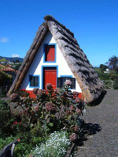 Santana parish has the largest number residents, while Arco de São Jorge is both the smallest, physically. Santana is known for the traditional homes constructed with sloping triangular rooftops, and protected with straw. These were mainly rural homes, used by local farmers, during the settlement of the island, with white-paintd walls, red doors and windows with blue trim. Most of the surviving buildings are tourist attractions, and maintained.