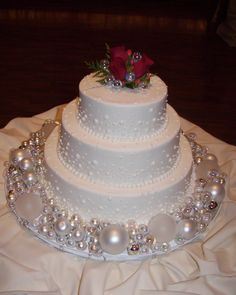 Bubbles or Bulbs?  Wedding cake - A Wedding cake inspired by Martha's bubble cake.  Instead of MS's hand blown sugar balls, I used various sizes of white, pearlized, and clear Christmas bulbs around this buttercream cake.