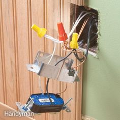 Electrical boxes must be flush with the wall surface, which can present problems when you add wainscoting or paneling. The easiest fix is usually a metal or plastic extension ring.