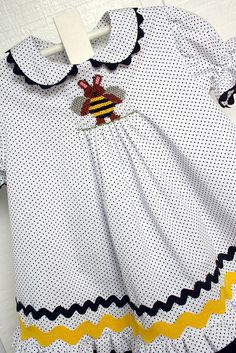 Both fabrics are Fabric Finder's pique. Pattern for top is Carol(Children's Corner), cut shorter for a top and added a ruffle. Pants pattern is Britches and Bloomers. Smocking plate is by Crosseyed Cricket- Bee Bunny Honey.