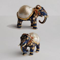 Gold and enamel figurine of an elephant with large natural baroque pearl forming its back and diamonds on its head. Mughal, India.:
