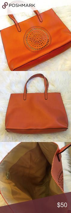"""✨NEIMAN MARCUS LARGE TOTE BAG✨ Large NEIMAN MARCUS laser cut orange tote bag. Two spots with very minor marks (pictured). Bag measures 20"""" x 14"""" inches. Excellent condition Neiman Marcus Bags Totes"""