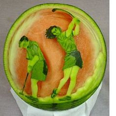 How cool is the watermelon sculpture of women playing #golf. Too pretty to eat!