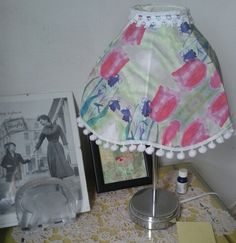 Upcycled charity shop lampshade using my own fabric.