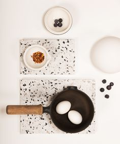 Confetti Terrazzo Board - OK Design  Love that terrazzo can be turned into many items such as palletes shown here. Good to use in kitchens because terrazzo is fire resistant, ideal for stoves, easy to maintain, great for cleaning up a mess  www.terrazzco.com