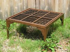 Hand made wood coffee table with a top made from reclaimed letterpress type boxes.