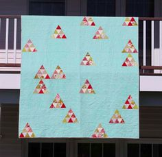 this is an interesting idea for a quilt using a favorite block. You could use a tetris or other pattern for the block layout - perfect for that teen to have a quilt with a hidden meaning, geeks rejoice!  Lily's Quilts: Issue 15 of Fat Quarterly is out now!