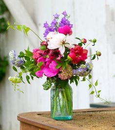 Garden-style peony bouquet: Use peonies to bring a pop of color to a bouquet of other blooms.