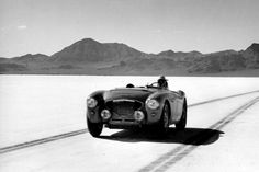 This great action shot features Donald Healey at the helm of an Austin Healey 100/4 on the salt flats of Bonneville in 1953