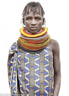 A woman from the Dassanech tribe in Ethiopia wears a brightly coloured beaded collar...