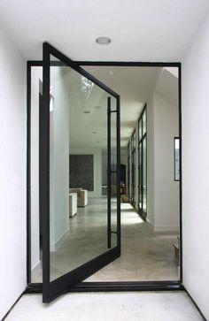 Architectural Detail: Pivot Door Roundup. Interessante, uma mistura de porta e parede, para espaço que precisam de iluminação.