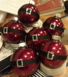 Glittering Santa Ornament - glitter the inside of a clear, round ornament with Glitter It! (you can find Glitter It! at Michaels or other craft stores). Secure a black ribbon around the middle of the ornament, and glue mini rhinestones for the buckle
