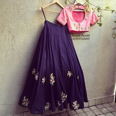 Pretty purple long skirt with pink blouse. Indian fashion.
