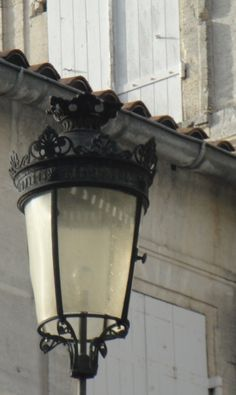 """Idle is the day and lantern the hour as I delight in the splendor of your kiss. Cognac France, Light Posts, Old Lanterns, Romantic Paris, Paris Girl, Street Lights, French Countryside, Street Lamp, French Chic"