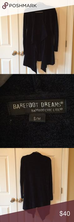 """Barefoot Dreams Calypso Wrap size s/m black The softest sweater you'll ever own!  It's like wearing your coziest blanket around town all day!!!  Barefoot Dreams Calypso Wrap cardigan sweater in size small/medium black color. Loose through the body & fitted through the sleeves.  Lovingly worn but in good used condition.  Back of sweater measures 31""""  long.  Comes from our nonsmoking home with a declawed cat. Barefoot Dreams Sweaters Cardigans"""