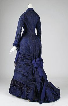 Back view.    Dinner dress Date: ca. 1876 Culture: American Medium: silk Dimensions: Total Length: 56 in. (142.2 cm) Credit Line: Gift of Theodore Fischer Ells, 1975 Accession Number: 1975.227.3