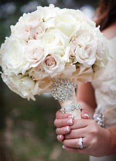 10 Wedding Bling Ideas: A simple bouquet of all white peonies or roses becomes a focal point when you add crystals and pearls.  As an alternative, use a brooch or bracelet to wrap the handle of the bouquet.