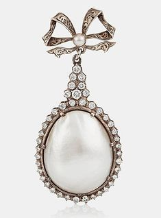 A LARGE NATURAL SALTWATER BLISTER PEARL AND BRILLIANT-CUT DIAMOND BROOCH.