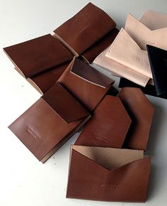 Hand cut leather card holders and wallets