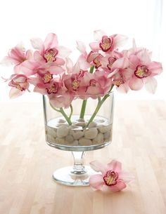 Fill the bottom of our Trifle Bowl with a layer of decorative stones before pouring water for your flower centerpiece.