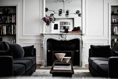 I think I found my dream apartment: Velvet Sofas, a giant fireplace, marble counter tops and the most beautiful lamps!! Designed by Jean Charles Tomas this Parisian Home is all a minimalist could ask