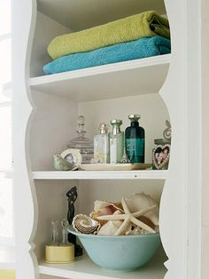 Double-Duty  A decorative shelving unit adds personality and storage to a bathroom. Use the unit to display decor items, such as pretty perfume and bath oil bottles, along with the daily necessities.