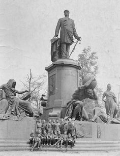 Soviet soldiers posing in front of the Bismarck statue