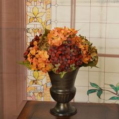 Hydrangea Urn Silk Floral Design AR324 - A wonderful accent for that certain spot, small size works great for any room. Created with burgundy, rust and green hydrangeas ina dark chocolate metal urn. 13 L x 13 W #SilkFlowers
