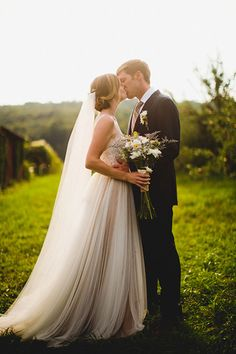 Bride in @willowbywatters Penelope wedding dress.