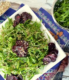 Baby arugula roasted beet salad with garlicky almond crumbs. If you haven't tried roasted beets, here is your chance! They taste heavenly!