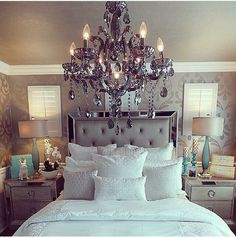 Wow love it all! The chandelier, headboard, wall paper everything!
