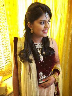Indian bride's bridal hair. Hairstyle by Swank Studio. Find us at https://www.facebook.com/SwankStudioBangalore