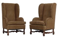 "Pair of large and substantial wing-back chairs with high backs, loose down-filled seat cushions and complimentary piping. Newly reupholstered in a rich, soft, sumptuous fabric with a paisley style print. These chairs have traditional provincial stretchers carved of walnut | 28""w x 31""d x 46""h x 20""seat ht x 24""arm ht 