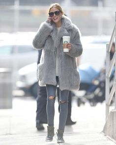 Olivia Palermoin an oversized faux fur coat and ripped skinny jeans. Starbucks…