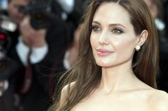 Angilina Jolie..I don't care what or who she did in the past or how she looks or what she wears.  This lady does great things for people....That makes her beautiful.