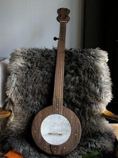 Custom-made fretless mountain banjo in your choice of hard wood (walnut, cherry, maple, or combination). Based on Hicks/Glenn mountain banjos of