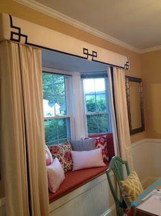 Transforms a plain bay window to a cozy nook. Would love to make a cornice.