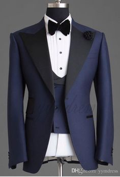 Dark Blue Groom Tuxedos 2019 One Button Peaked Lapel Slim Fit Fashion Design wedding suits for men Three Pieces (Jacket+Vest+Bow) Source by newhighmensfashion Blazer For Men Wedding, Mens Beach Wedding Attire, Prom Suits For Men, Wedding Dress Men, Wedding Suits For Groom, Tuxedo Wedding, Groom Tuxedo, Tuxedo Suit, Tuxedo For Men
