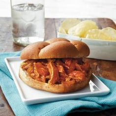 You already love pulled chicken, so why not try it in a slow cooker? Savor this tender, melt-in-your-mouth chicken sandwich with ketchup-based sauce for lunch or dinner.