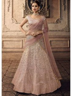 Dusty Pink net semi stitch lehenga with net choli. This lehenga choli is embellished with zari, stone and sequins work. Product are available in 32 to 58 sizes. It is perfect for Bridesmaid Wear, Guest of Wedding Wear, Party Wear, Wedding Wear. Lehenga Anarkali, Pink Lehenga, Bridal Lehenga Choli, Indian Lehenga, Pakistani Bridal, Anarkali Suits, Bridal Lehenga Online, Designer Bridal Lehenga, Lehenga Choli Online