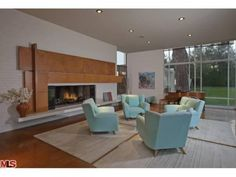 Crazy good furniture choices and wonderful fireplace detail.  Glassy Home was Rumored Rendezvous of Marilyn Monroe and JFK | Zillow Blog