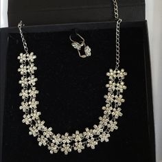 Say Bella Crystal Necklace and Earring Set Worn once for my wedding. Bought this at a wedding boutique. Absolutely stunning comes with the case to hold the necklace and earrings in. Last two pics are of what it looks like on. Jewelry Necklaces
