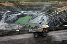 A haul truck carries uranium ore from the Ranger uranium mine in the Northern Territory. Description from abc.net.au. I searched for this on bing.com/images