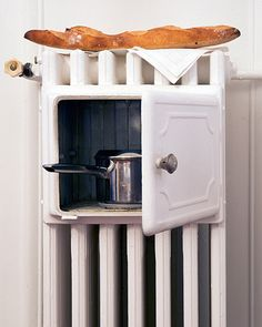 Built in warming cubby in a hot water radiator. Wow, I have never seen any thing like this...how cool!