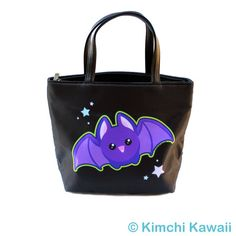"""Bucket bag purse featuring my Kawaii Bat design. Perfect for Halloween, or any time for that matter!  Inside has pockets for cell phones/small items.  Approximate dimensions: 10.5""""L x 4.5""""W x 8""""H"""