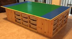 The Lego table goes awesome! Uses 4 IKEA's TROFAST frames. 4 feet x 6 feet table top. Legos are organized by color in the bins.